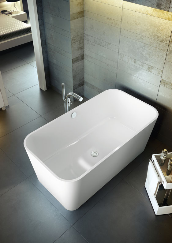"The New tub from Victoria + Albert is called ""The Edge"".  Strikingly linear contrasted with soft contoured corners, this double ended design is perfect for two people.  To compliment the tub, Victoria + Albert also offers a white rimless basin which mirrors the tub's shape.  Both pieces are made of volcanic limestone and hand finished."