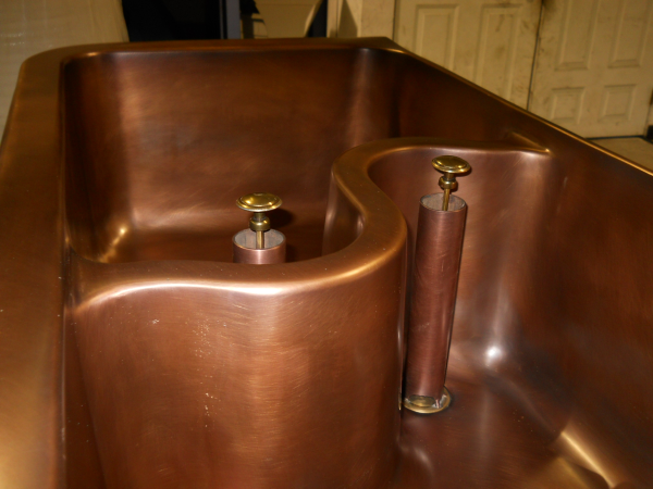 Solid Bronze Copper Farm Style Kitchen Sink with a smooth outer finish and a hammered interior.  Solid copper, Polished Nickel, or Stainless Steel kitchen sinks farm style as well as under mountable are very popular in the luxurious kitchen.