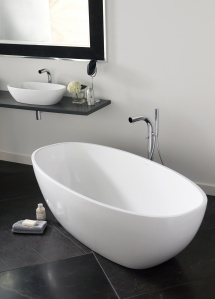 The Victoria + Albert freestanding Barcelona Bath, pebble-shaped, features a rimless, double-ended design that's big enough for two.  Crafted of Englishcast (a composite material with finely ground volcanic limestone), it is cast in one seamless piece and has a glossy white solid surface.